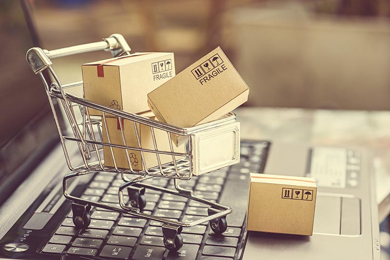 Paper boxes in a shopping cart.